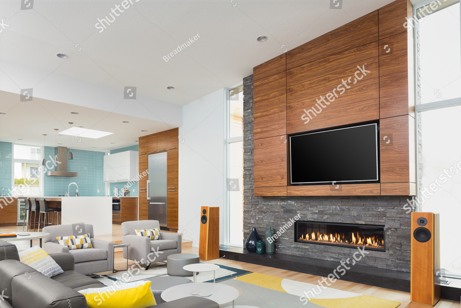 stock-photo-beautiful-living-room-and-kitchen-in-new-contemporary-style-luxury-home-features-beautiful-1395664487