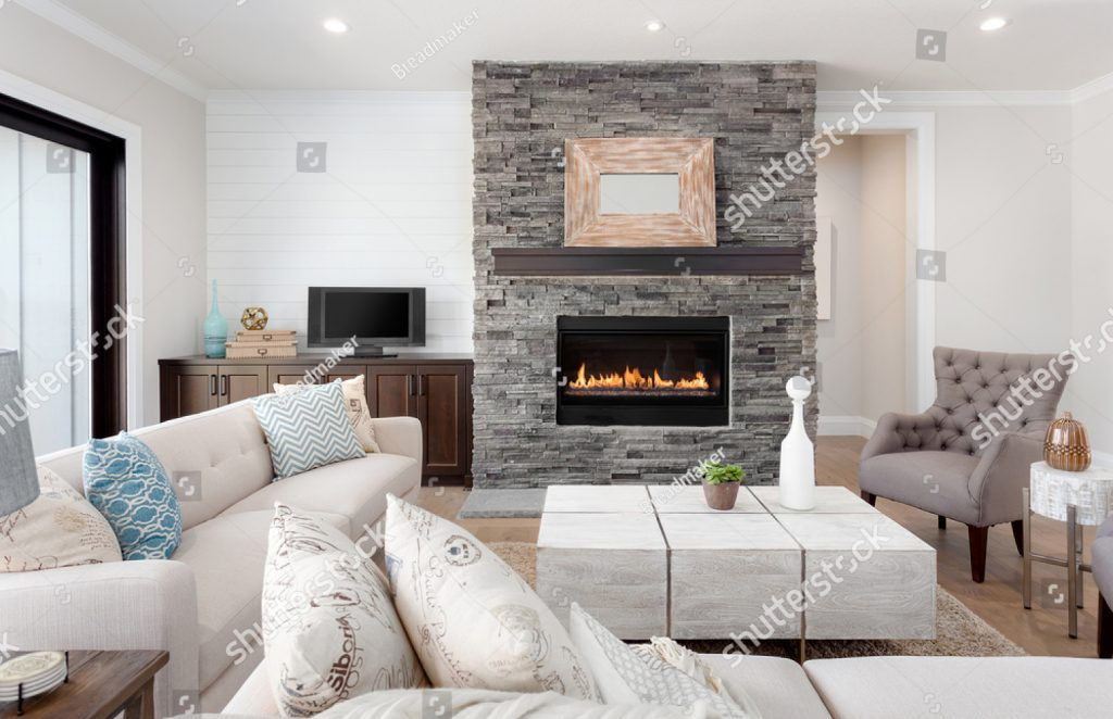 stock-photo-beautiful-living-room-interior-with-hardwood-floors-and-fireplace-in-new-luxury-home-couches-at-653501032