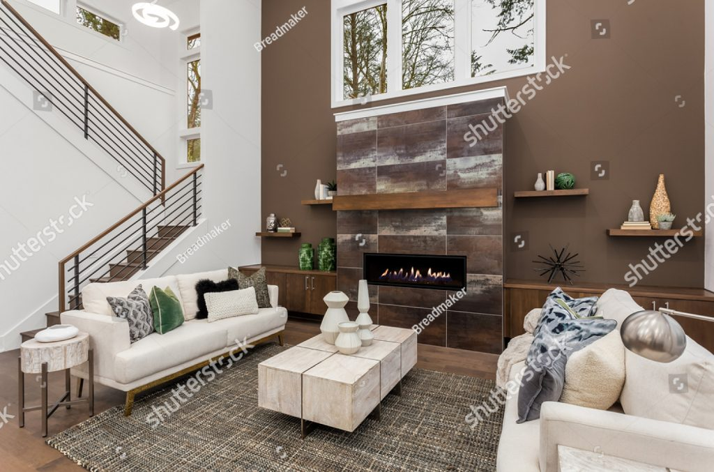 stock-photo-beautiful-modern-living-room-with-vaulted-ceiling-in-new-luxury-home-features-stone-fireplace-1950204178