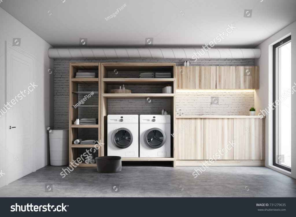 stock-photo-modern-laundry-room-interior-with-white-brick-walls-wooden-consoles-and-shelves-with-two-white-731279635