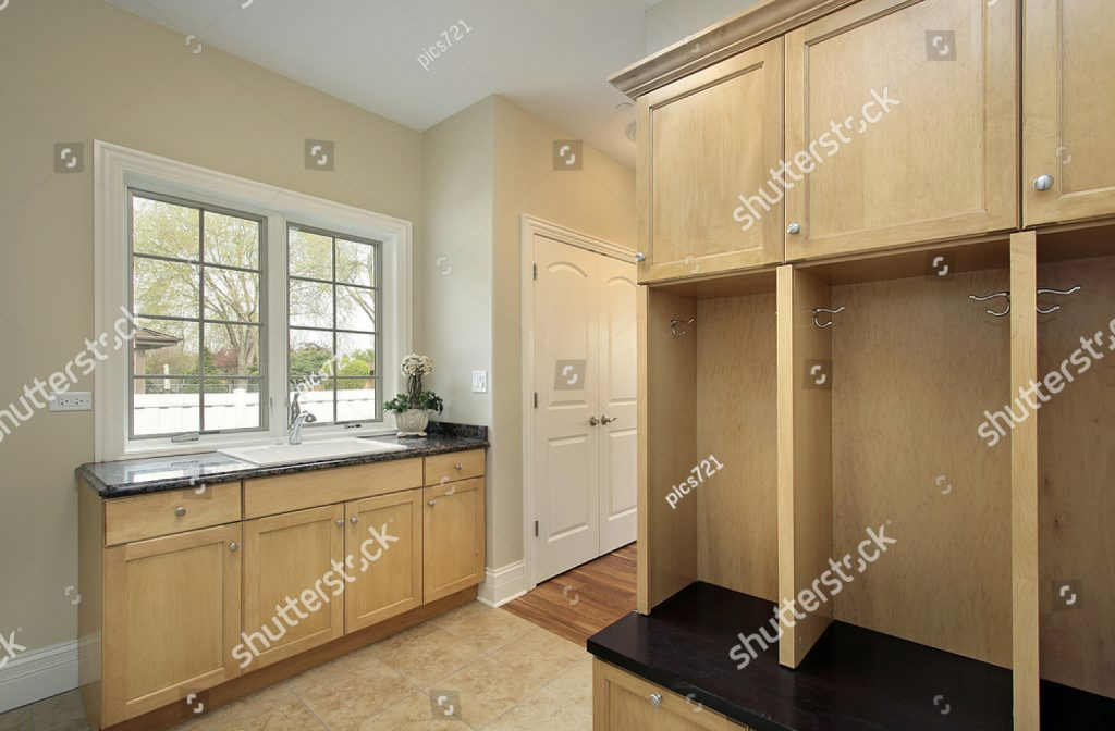 stock-photo-mud-room-in-new-construction-home-with-oak-cabinetry-32883442