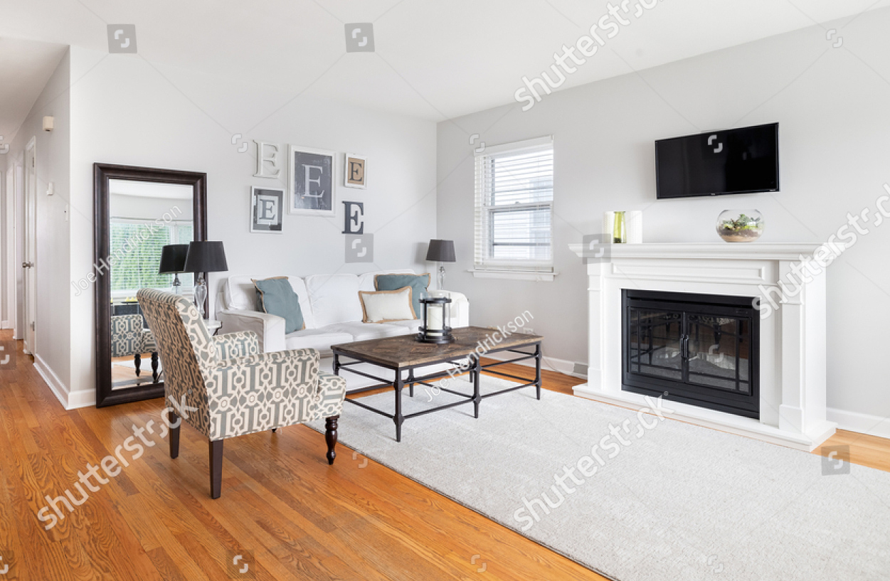 stock-photo-oak-park-il-usa-october-a-cozy-living-room-with-a-white-fireplace-under-a-mounted-1956952924